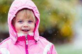 Happy toddler in warm coat