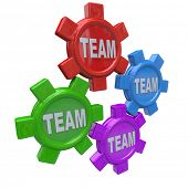 Four gears turning together in unison, representing working together or collaborative toward a commo