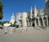 Avignon, France - Oct 1: Tourists Stroll In The Plaza Of The Palace Of The Popes,  On Oct 1, 2011 In