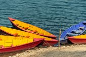 Colorful barques on Phewa Lake in Pokara, Nepal