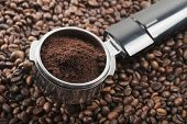 stock photo of dispenser  - full coffee dispenser on bunch coffee beans