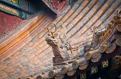 stock photo of lamas  - Roof details in Yonghe Temple also known as Palace of Peace and Harmony Lama Temple or simply Lama Temple in Beijing China - JPG