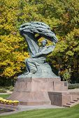 picture of chopin  - Autumn in Lazienki park with monument of pianist Friderick Chopin Warsaw Poland - JPG