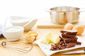Ingredients for a mousse au chocolat including dark chocolate, eggs, butter, cream and sugar