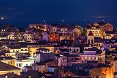 Panoramic View Of The Citylights Of Corfu Town At Night. Kerkyra. Greece, Corfu Island