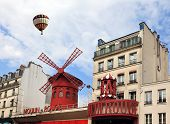 Big balloon flies over the Parisian cabaret