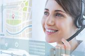 stock photo of hologram  - Pretty call center employee using futuristic interface hologram looking at map - JPG