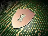 Privacy concept: Shield With Keyhole on circuit board background