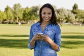 Outdoor portrait of a beautiful African American talking at phone