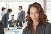 stock photo of work crew  - Happy businesswoman on business meeting at office - JPG
