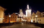 Tourists near Charles bridge in Prague at night.