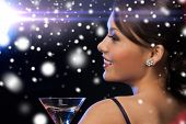 luxury, vip, nightlife, party, christmas, x-mas, new year's eve concept - beautiful woman in evening dress with cocktail