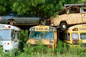 Scrapped Vehicles Sit Stacked In Auto Junkyard