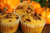 pic of patty-cake  - Pumpkin muffins with nuts and pumpkin in background - JPG