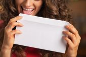 Closeup On Happy Young Woman Licking Envelope