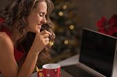 Happy Woman Having Christmas Cookies With Cup Of Hot Chocolate A