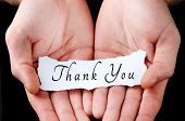 image of gratitude  - Man holding thank you word in palm - JPG