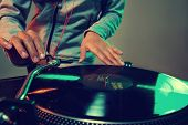 foto of mixer  - Dj hands on equipment deck and mixer with vinyl record at party - JPG