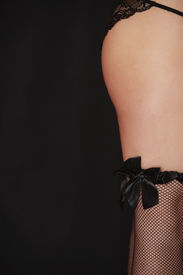stock photo of fishnet stockings  - Fishnet stocking on a beautiful young adult caucasian full figured woman - JPG
