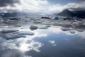 Fjallsarlon Glacier Lake, Sky Reflection In The Water