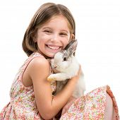 Easter photo. happy little girl with her  rabbit close-up.  Isolated on white background