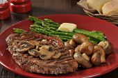 stock photo of sauteed  - Grilled rib steak with asparagus and sauteed mushrooms - JPG