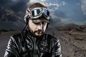 biker with black leather jacket and old glasses