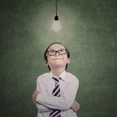 Businessman Boy Looking At Lit Bulb