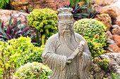 Wise man statue in garden