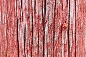 Cracked And Softened Red Board Wall