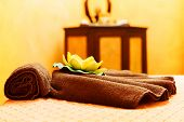 stock photo of thai massage  - Towels and orchid flower decorating a massage table for thai massage. ** Note: Shallow depth of field - JPG