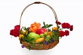 stock photo of pentecostal  - Colorful basket of fruit decorated with flowers isolated on white - JPG