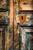 picture of peep hole  - Detail of vintage key hole on weathered wooden door