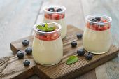 pic of panna  - Dessert panna cotta with fresh strawberry on wooden background - JPG