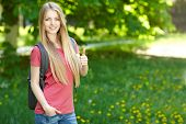 Smiling woman student with backpack