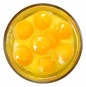 Raw Eggs in Glass Bowl Isolated Over White