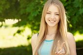 picture of peace-sign  - Summer girl portrait - JPG