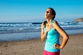 stock photo of breathing exercise  - Exhausted female runner suffering painful angina pectoris or asthma breathing problems after training hard 