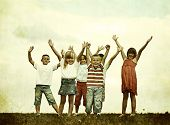 Filtered imag of a roup of kids having happy time in nature