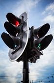 image of traffic signal  - Red stop signal for cars and green pedestrian light on urban traffic light - JPG