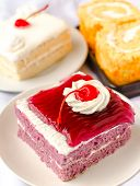 Cake With Mousse Whipping Cream And Cherry On Top