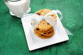 Chocolate Chips Cookies With A Bow And Milk