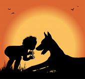 silhouette of boy and dog in a meadow