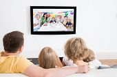 foto of watching movie  - Young Family Watching TV Together At Home - JPG