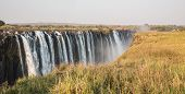 Panoramic view of Victoria Falls with toruists in Zimbabwe