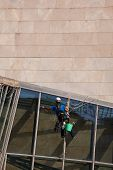 BILBAO, SPAIN - SEPT 3 2014 : A window cleaner is at work on the Guggenheim Museum exterior