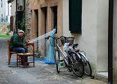 Fisherman Mending Net in Grado
