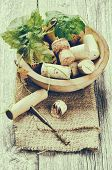 Wine Corks And Corkscrew In Rustic Setting