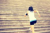 stock photo of ponytail  - Runner athlete running on stairs - JPG