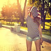 Funny Hipster Girl with USA Flag on her Head